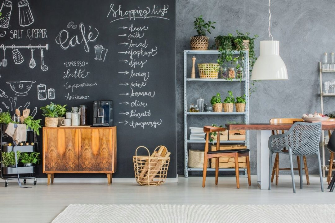 trendy kitchen layout with writing on wall